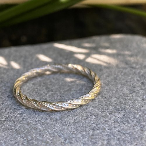sterling silver stacking ring - dazzle design rests on a stone