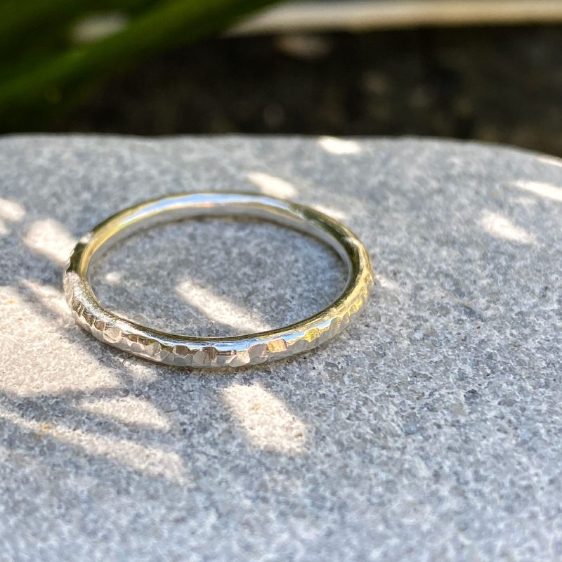 sterling silver stacking ring with a hammered texture on stone