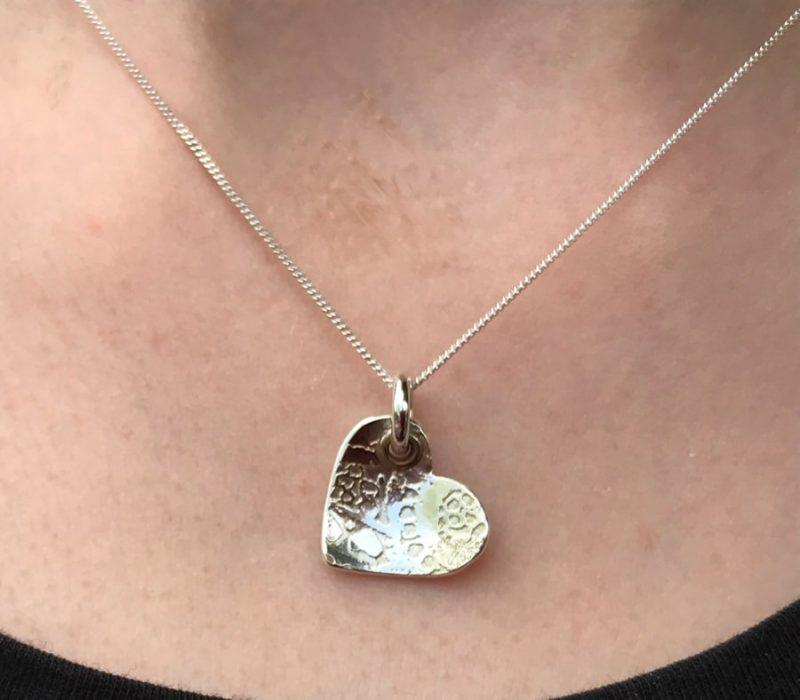 sterling silver heart pendant on model