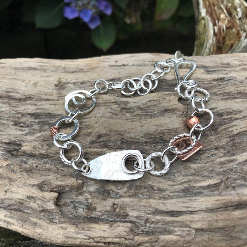 bracelet lying on a piece of wood