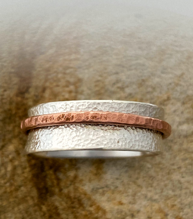 Sterling silver spinner ring with single copper band