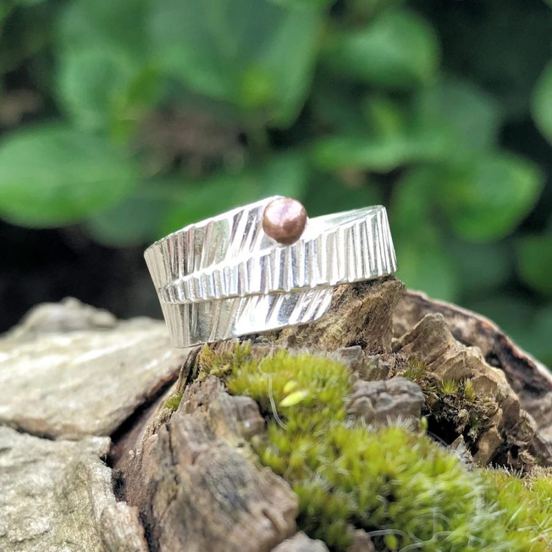 Textured sterling silver Wrap around ring finished with a copper ball