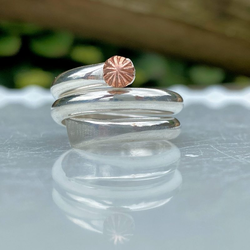 handcrafted sterling silver wrapped three times with a copper seaflower at the top