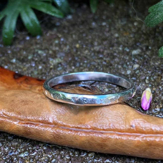 sterling silver stacking ring with a lightly hammered texture on a leaf