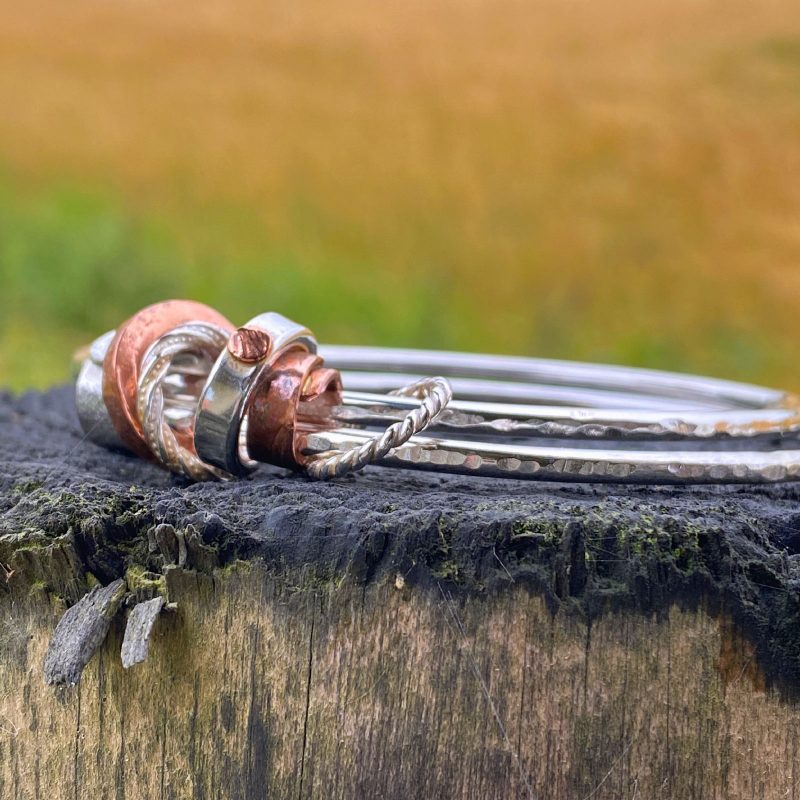 closeup of the sterling silver and copper beads on the double bangle bracelet