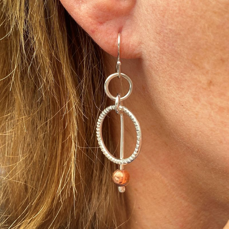 handcrafted sterling silver circle earrings modelled