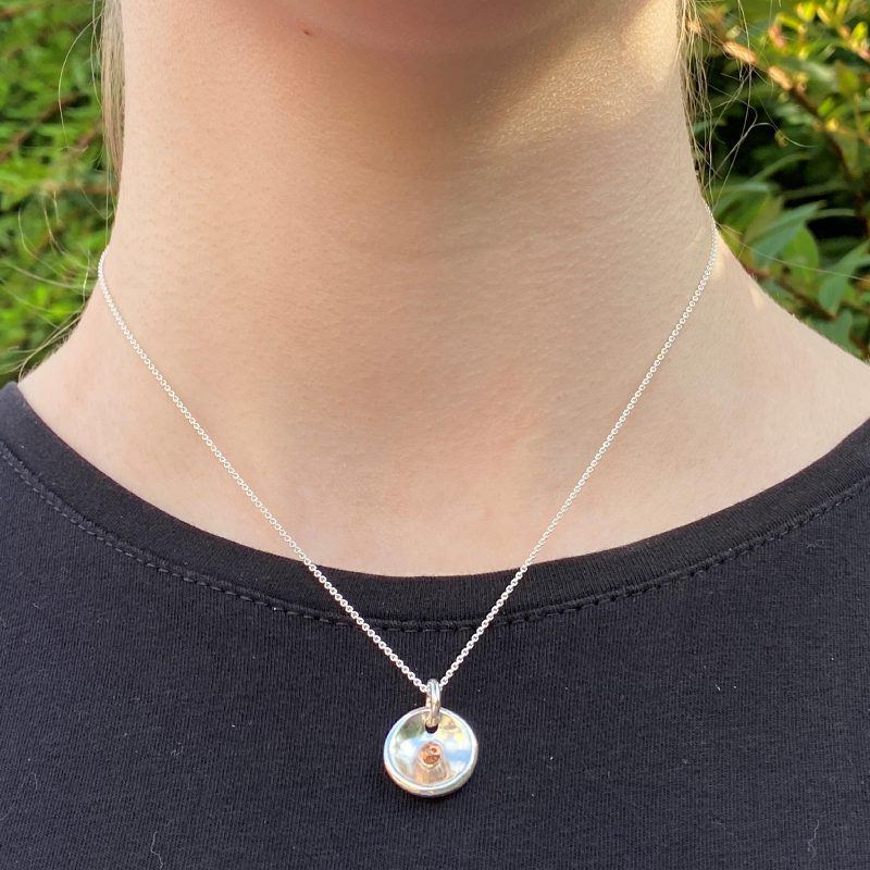 model wearing the silver melted puddle pendant
