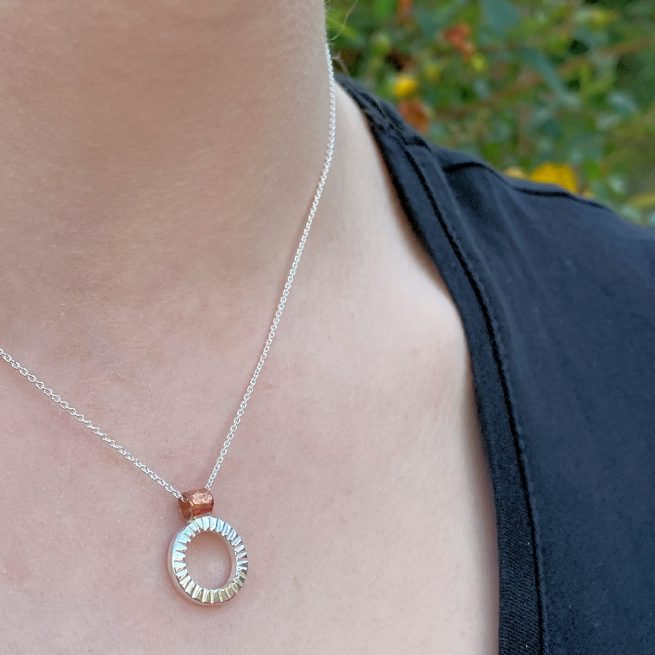 model wearing the textured circle necklace