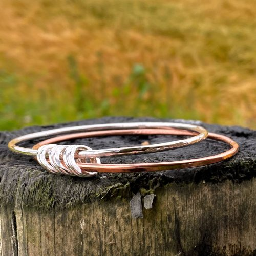 handcrafted sterling silver and copper bangle bracelet with 6 rings