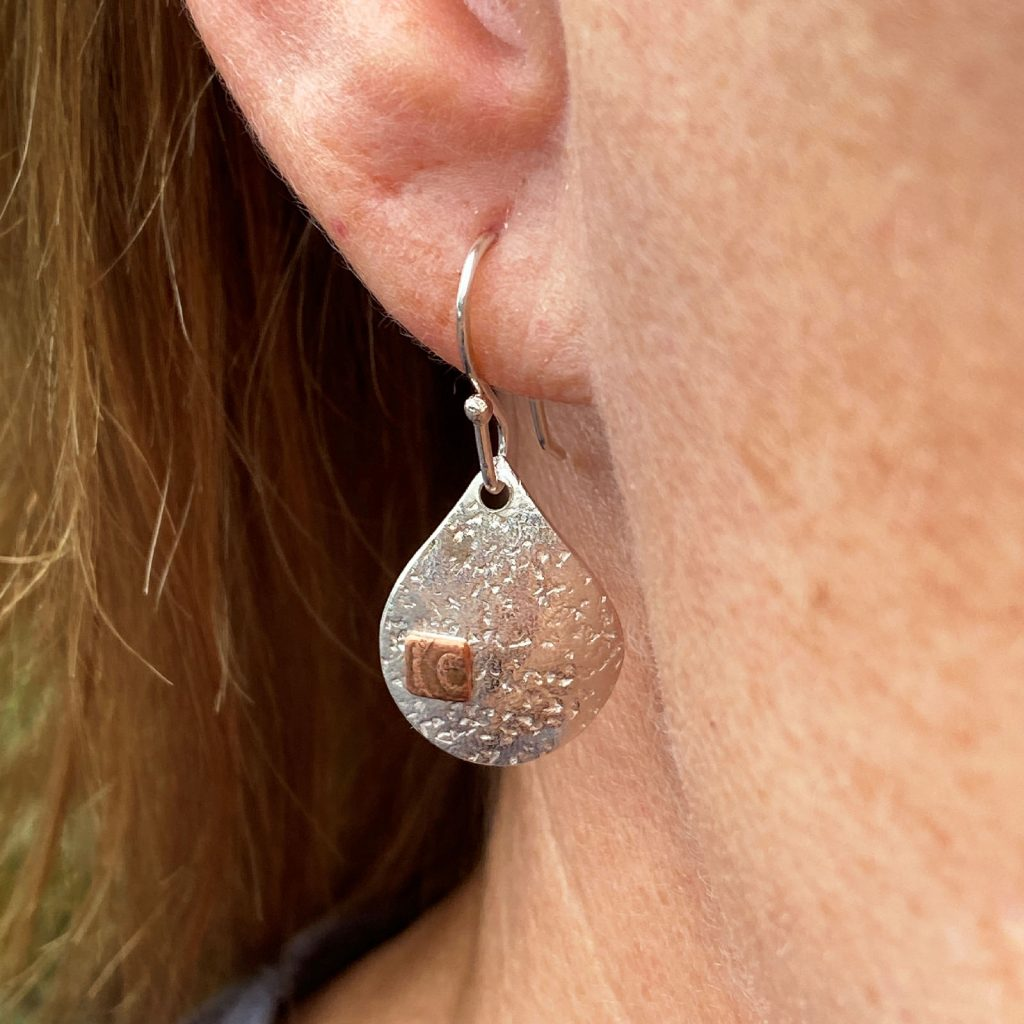 handcrafted sterling silver and copper raindrops dangling earrings modelled