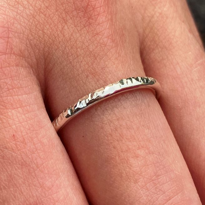 sterling silver stacking ring with hammered texture modelled