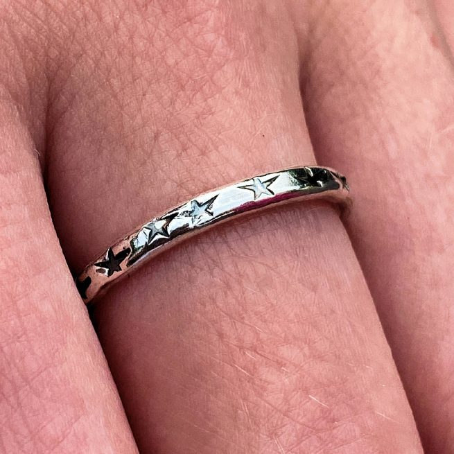 sterling silver stacking ring with star design modelled