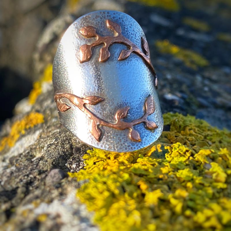 handcrafted sterling silver and upcycled copper saddle ring