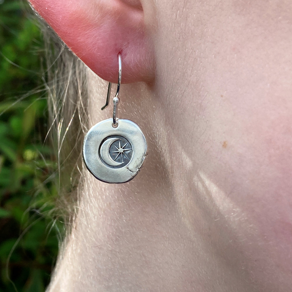 clloseup of model wearing the moon and star earring