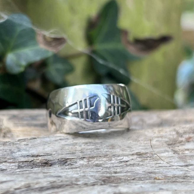 hand forged wide band silver ring with arrow head stamp